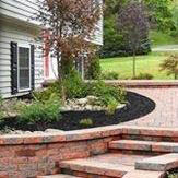 Retaining wall and walkway with landscape plantings