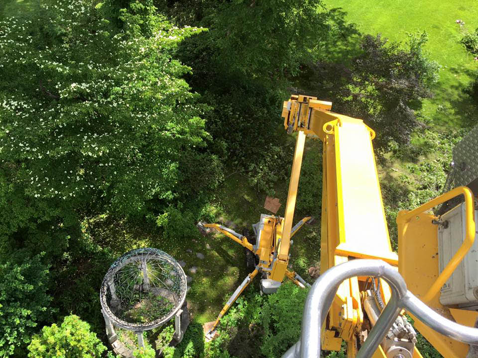 OMME aerial lift equipment reaching 92' in vertical height