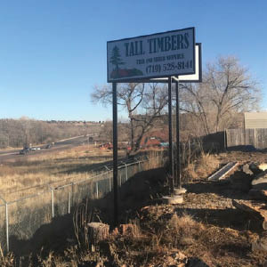 tall timbers tree & shrub services sign