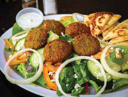 Falafel perfectly seasoned with salad and pita bread
