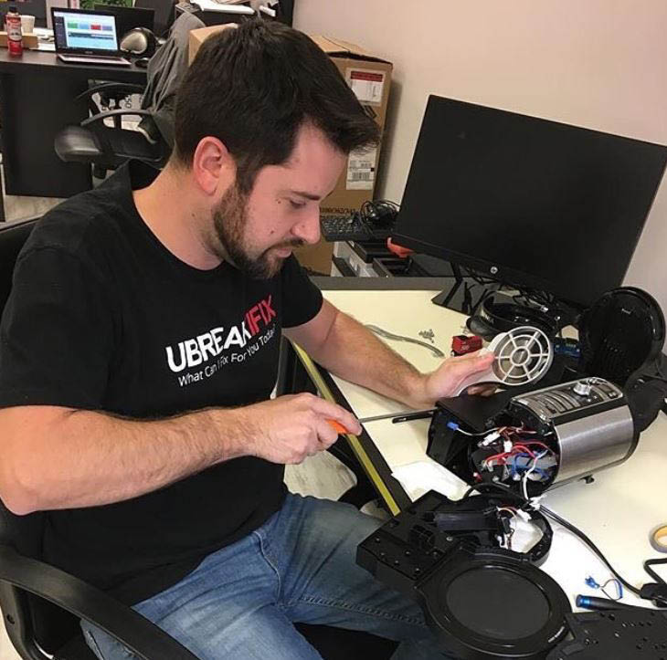 One of our uBreakIfix technicians repairing electronic device