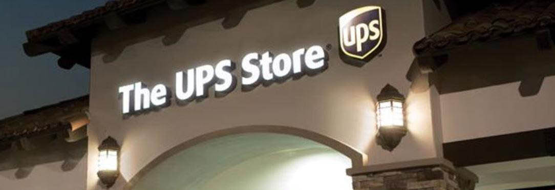 Exterior building showing The UPS Store logo banner