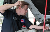 Nicholasville auto technician does oil change service
