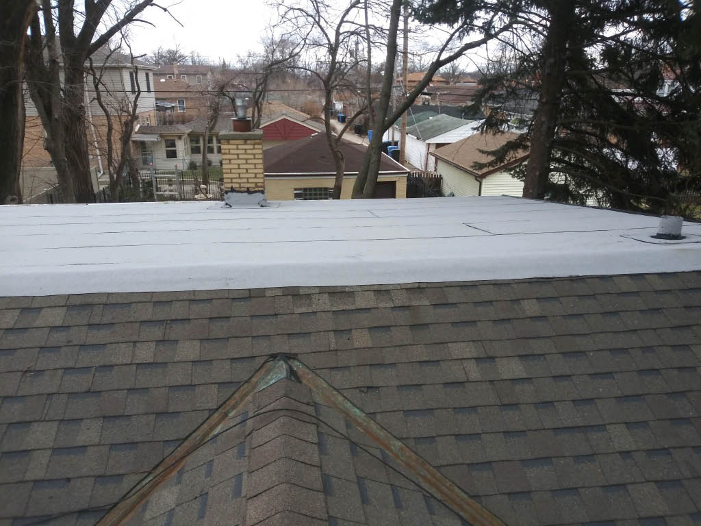 Grey shingled roof by Velasco Roofing