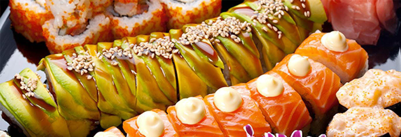 Sushi rolls created fresh by the Sushi Village chef banner
