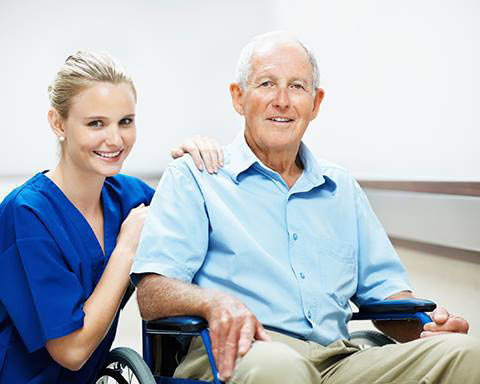A visiting angel caregiver with a patient