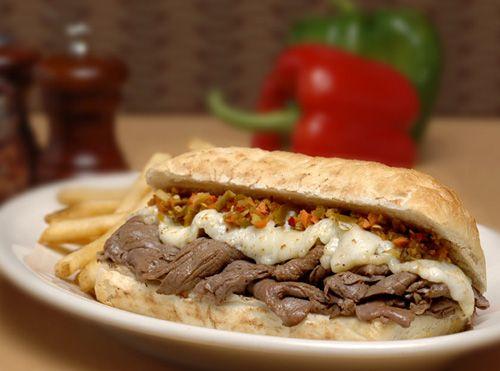 Italian beef sandwich served on cheesy garlic bread