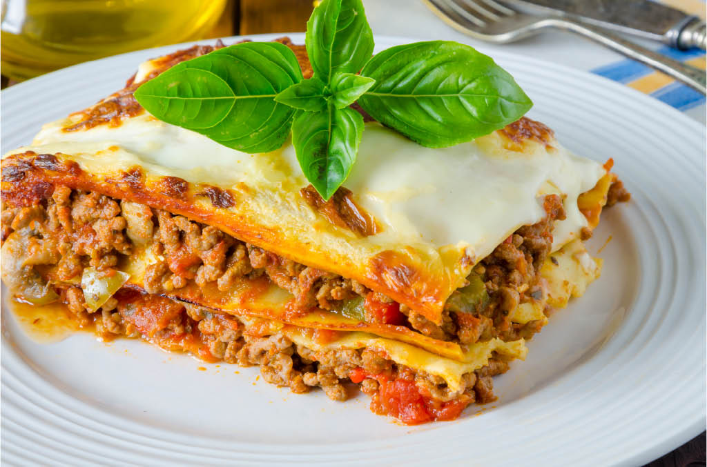 Serving of freshly-baked lasagna at our Italian restaurant