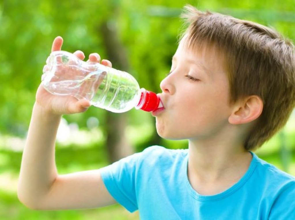 young boy drinking water from a water bottle in Concord, CA; water that tastes good; pure water; water filtration Northern California