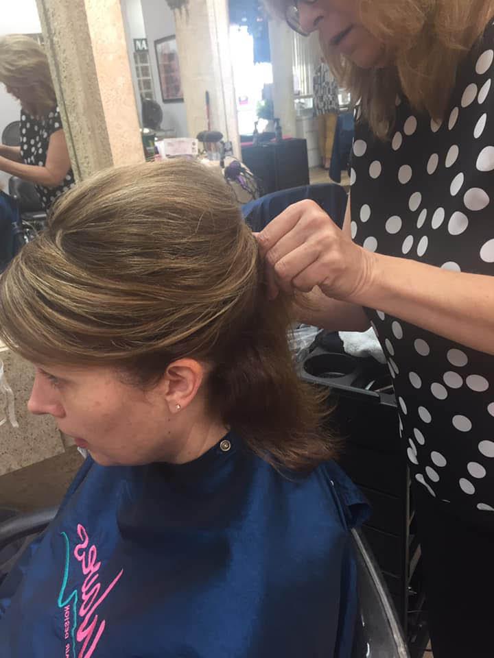 woman getting a haircut in New Smyrna Beach, FL