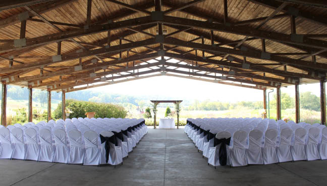 Picture of All Star Chair Rentals servicing the Milwaukee area. Chairs in a cover patio set up for a wedding.