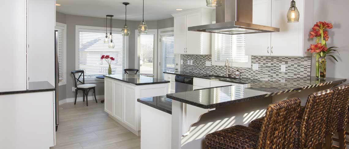 Beautiful white tiled kitchen.