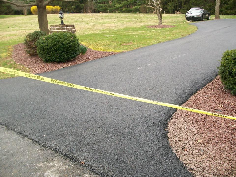new paved driveway; sealcoating