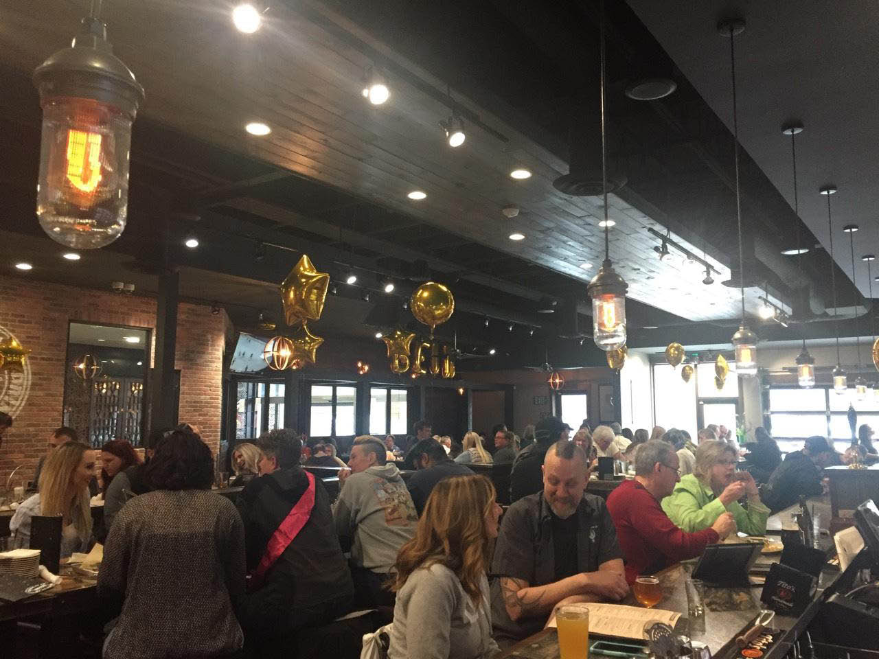 crowd enjoying World of Beer beers, drinks, and food in Washington.
