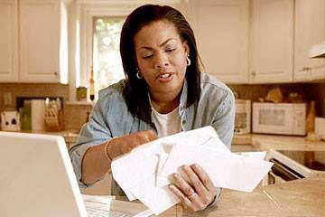 Woman sorting her bills.