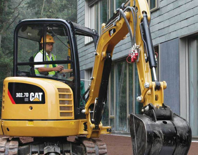 man finishing a home project in rented equipment