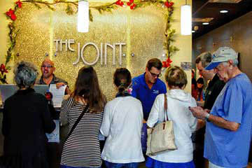 The Joint Chiropractic reception assisting patients