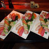 Beautifully plated presentations of sushi and sashimi