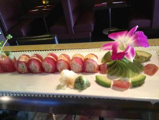 Sushi rolls with avocado and flower arrangements in Riverside, RI.