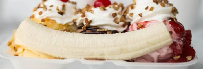 Banana Split with classic vanilla, chocolate & strawberry ice cream banner