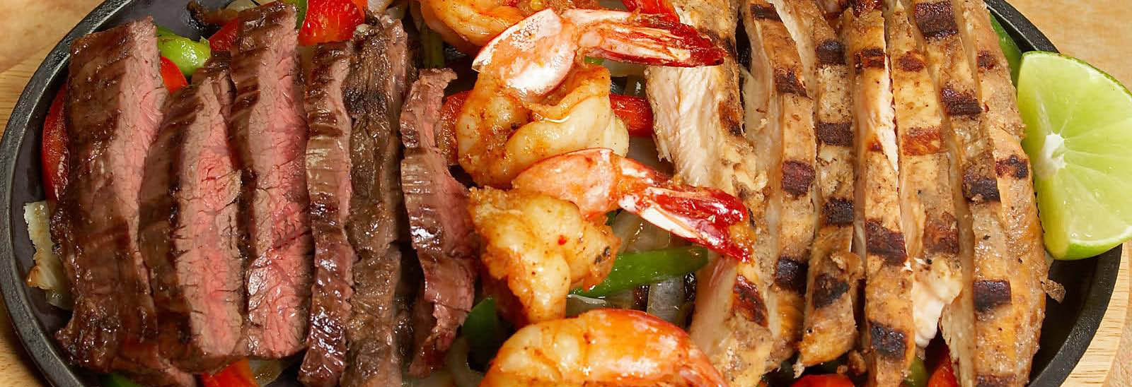 Mexican Combo Platter with beef, shrimp and chicken banner